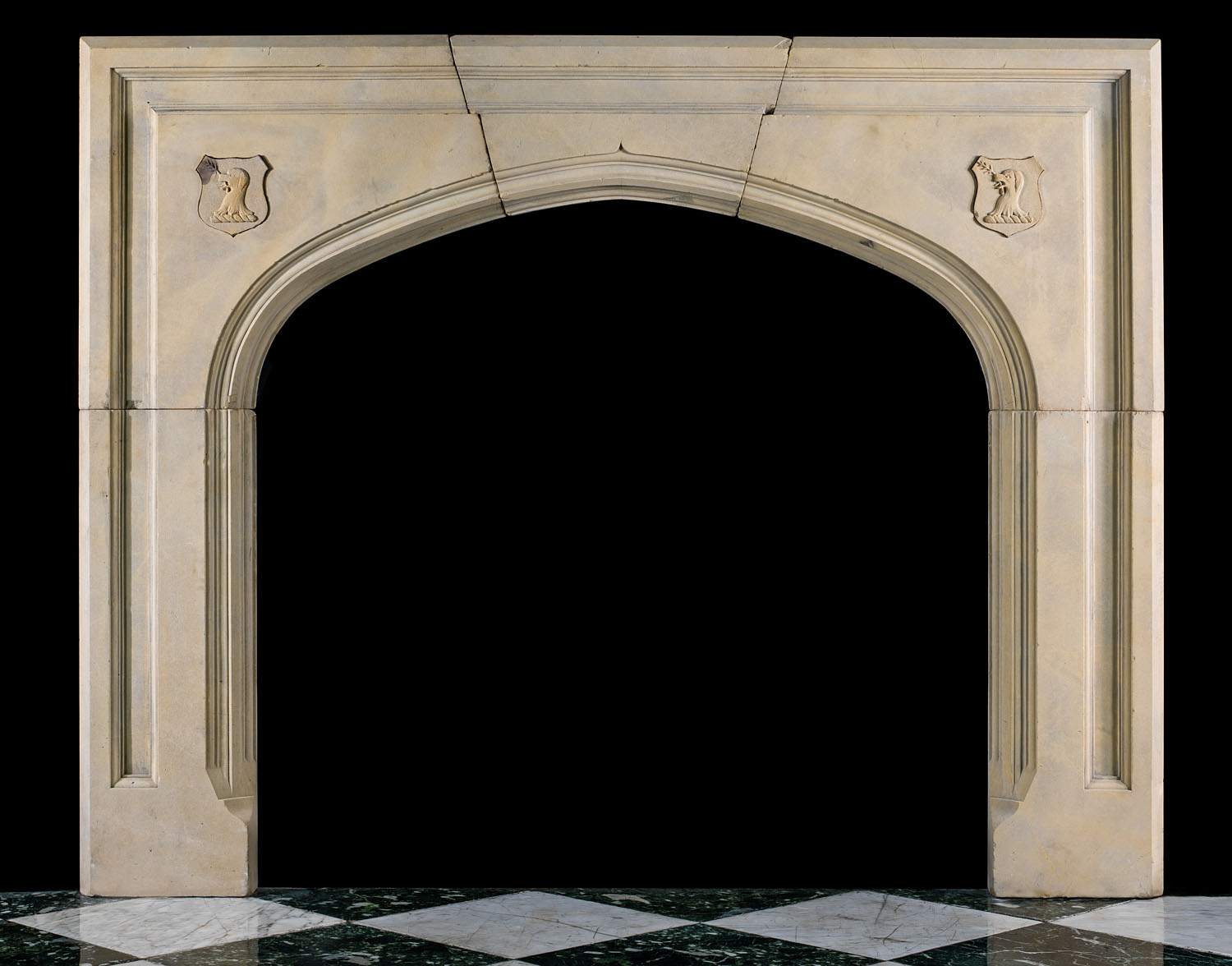 A Victorian Gothic Revival antique Yorkstone fireplace mantel