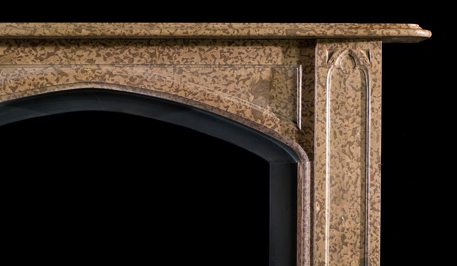 An antique Gothic Revival Coral Fossil Fireplace Surround