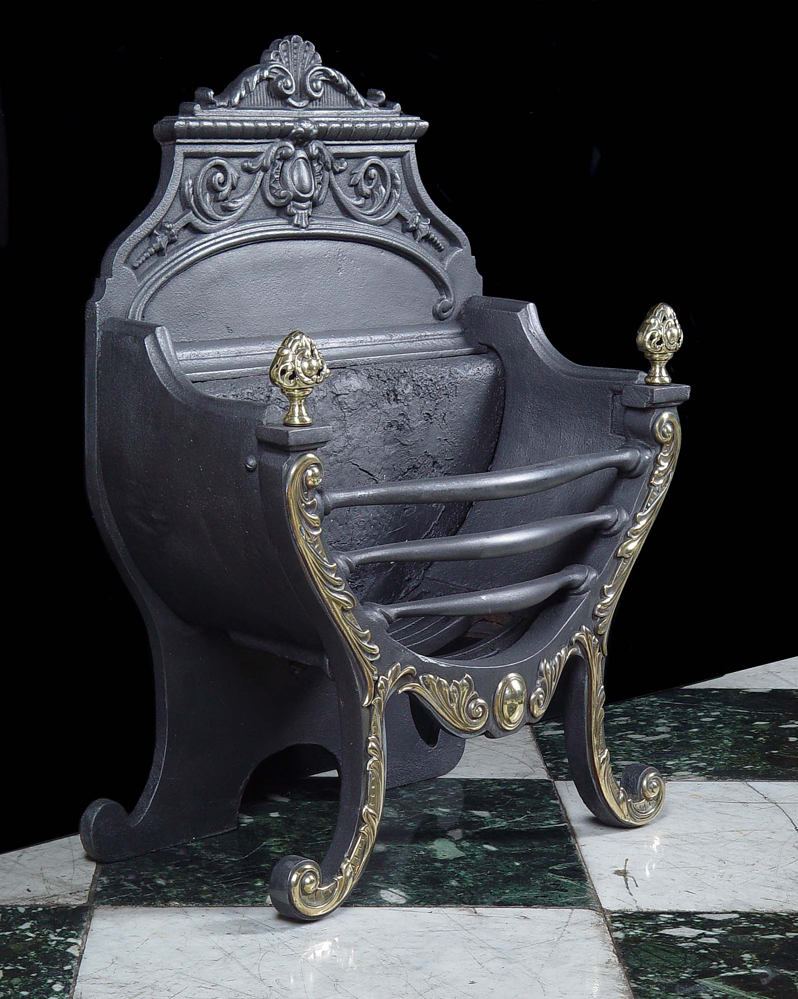 A Rococo style Victorian cast iron and brass mounted fire basket