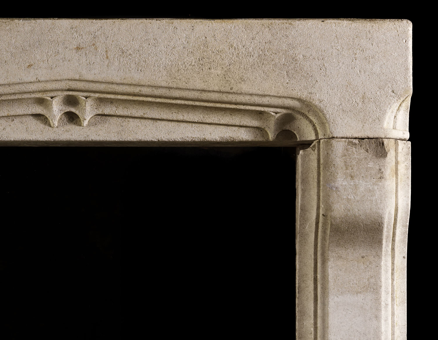 A Gothic Revival limestone chimneypiece