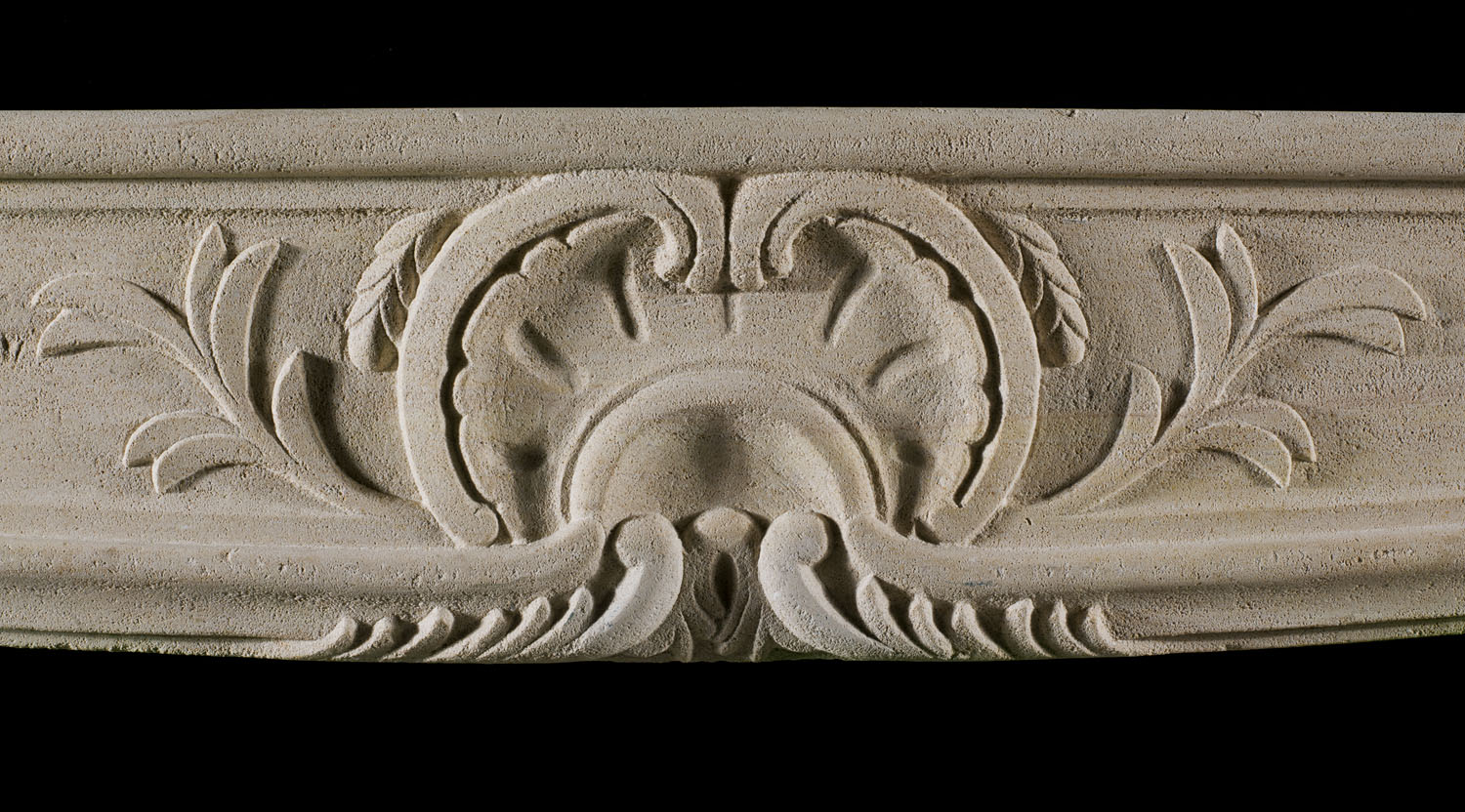 A French Louis XV limestone antique chimneypiece