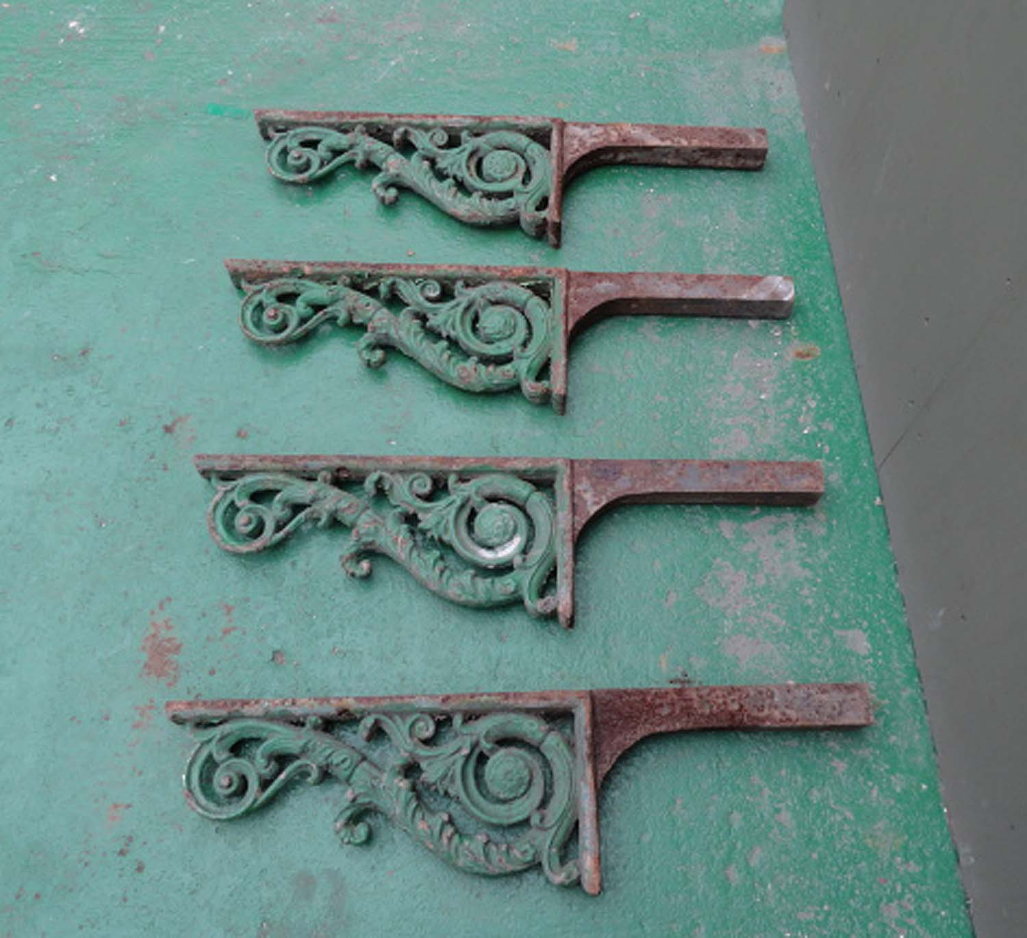Antique Scrolled Cast Iron set of Four Brackets