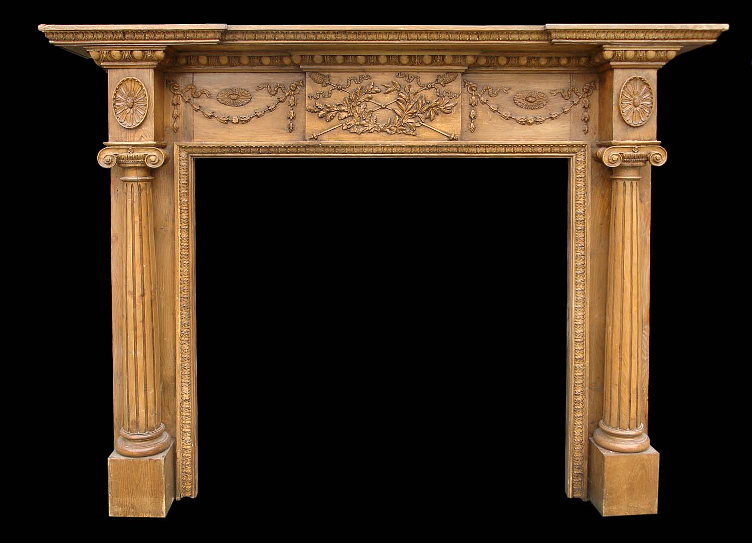 A mid 20th century Georgian style pine fireplace surround