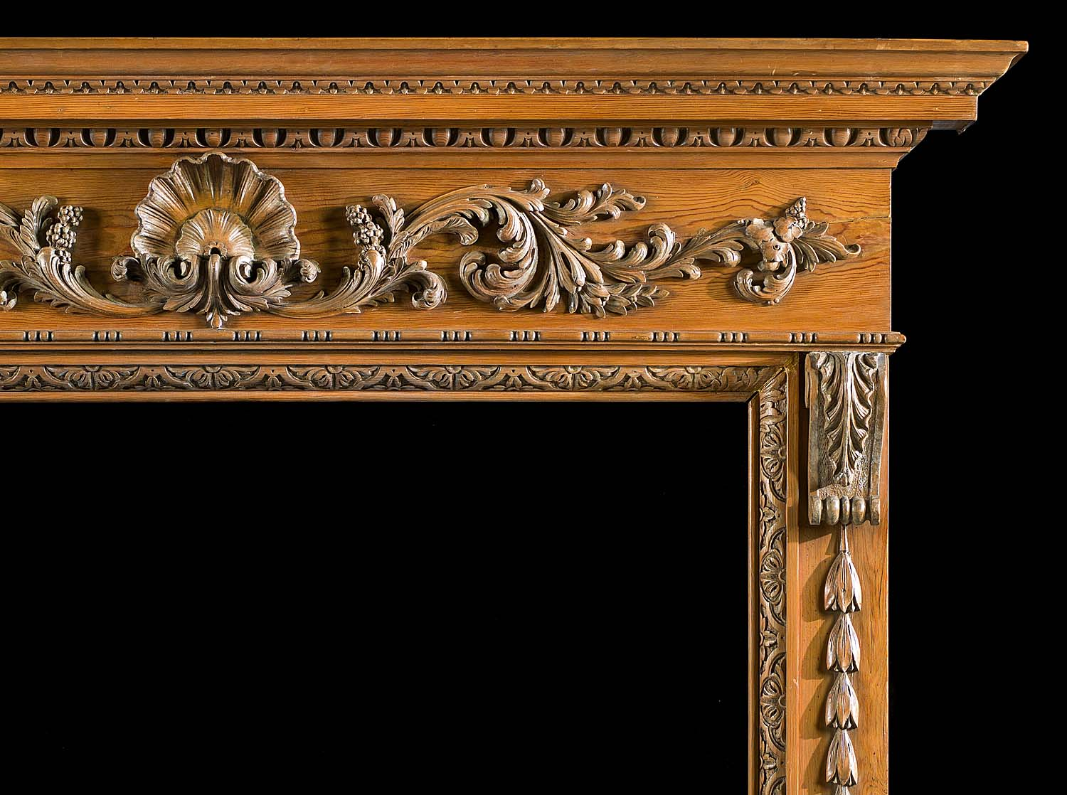 A carved pine Georgian style Chimneypiece