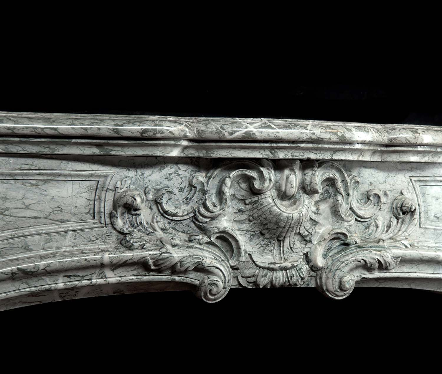 An antique Campana Marble Rococo Fireplace Mantel