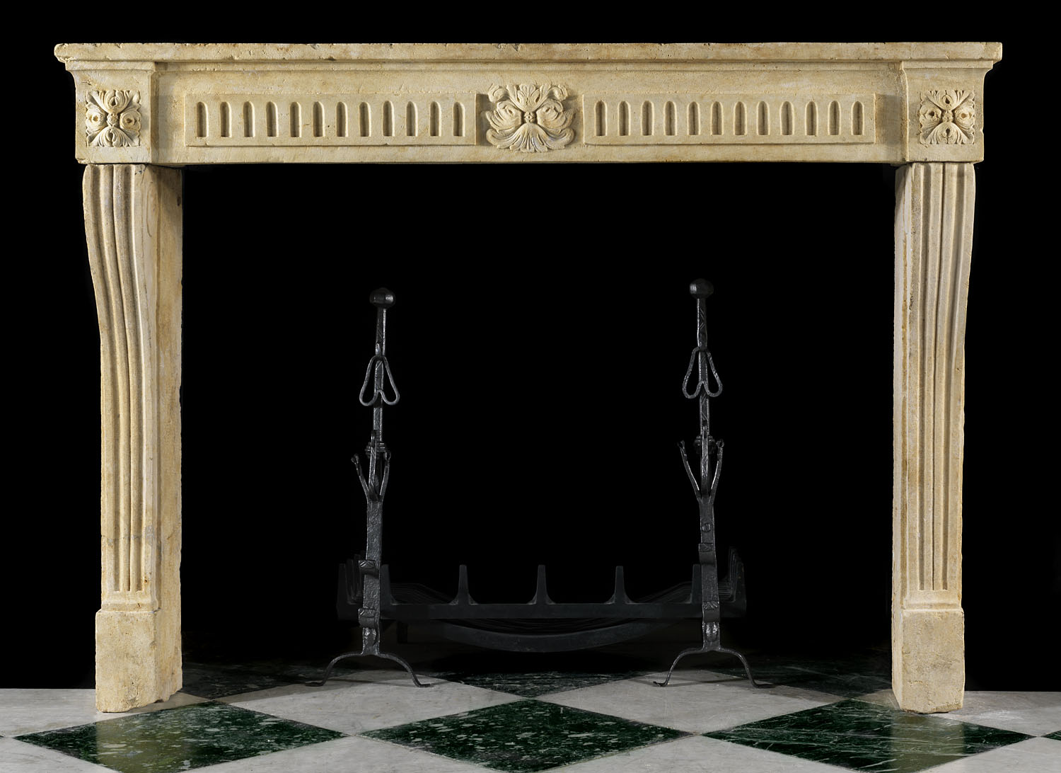Antique Louis XVI limestone fireplace surround