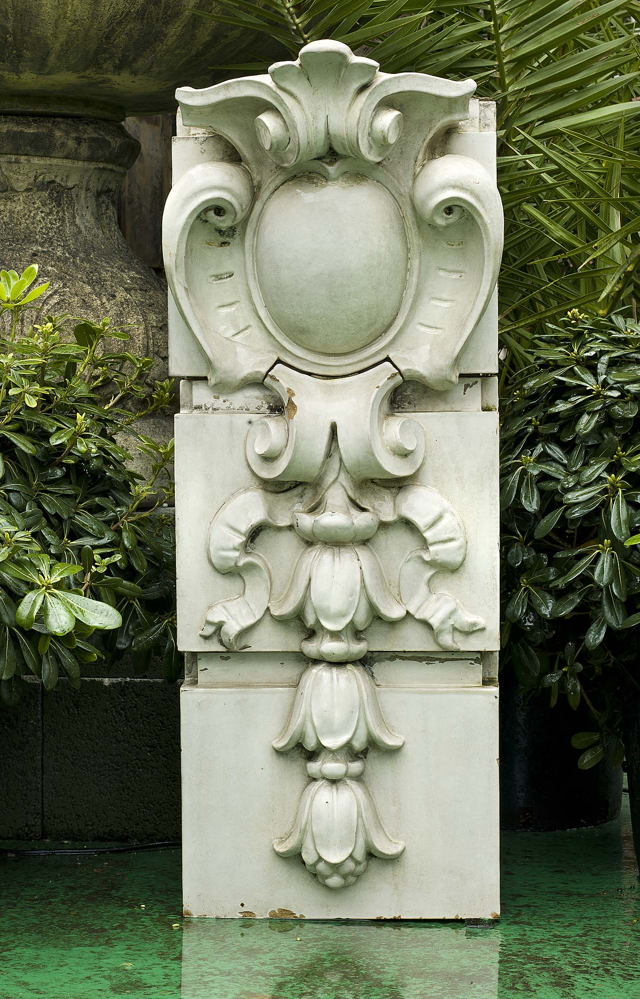A large antique stone keystone in three sections