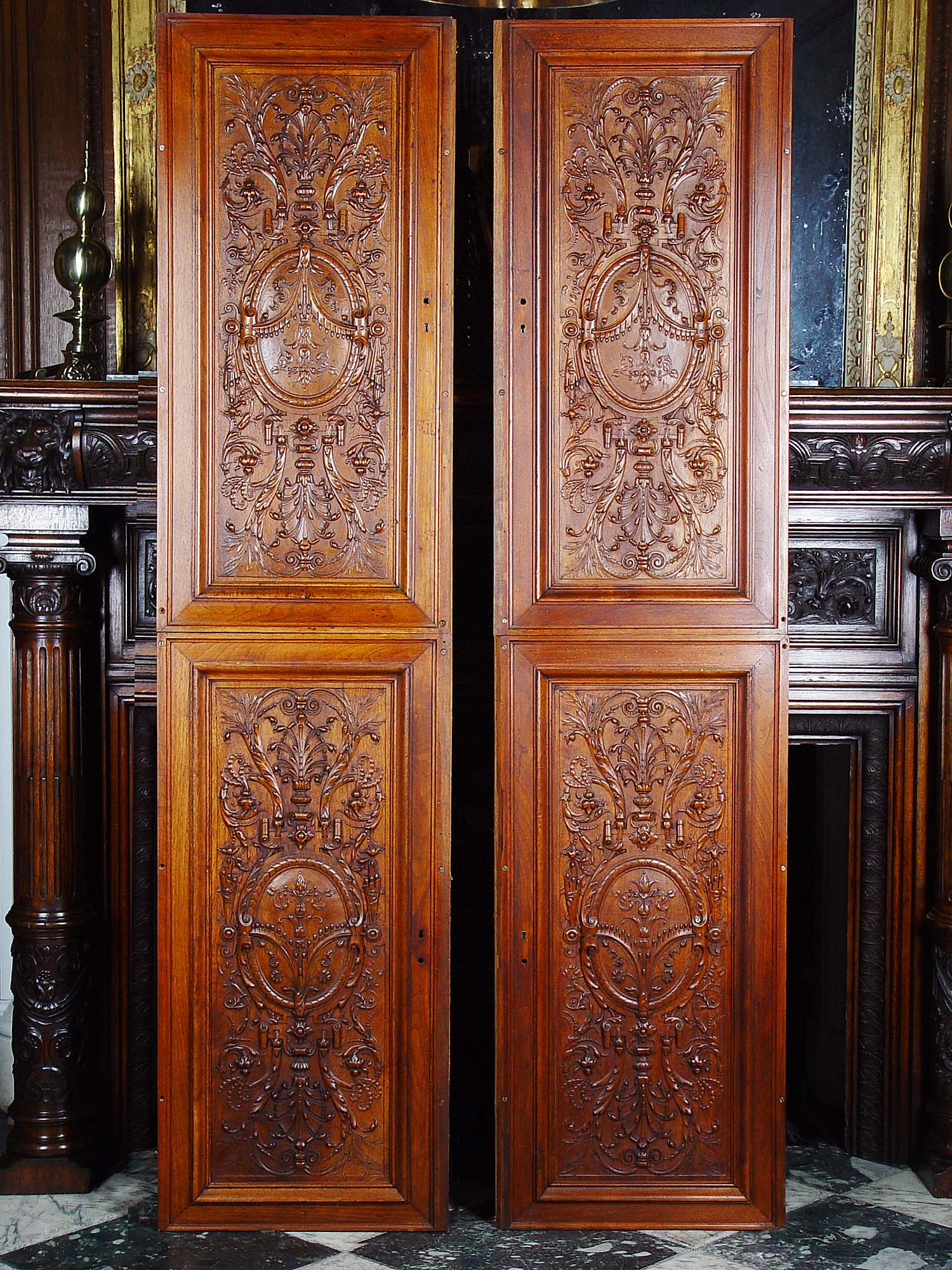Antique carved walnut panels in the Renaissance manner