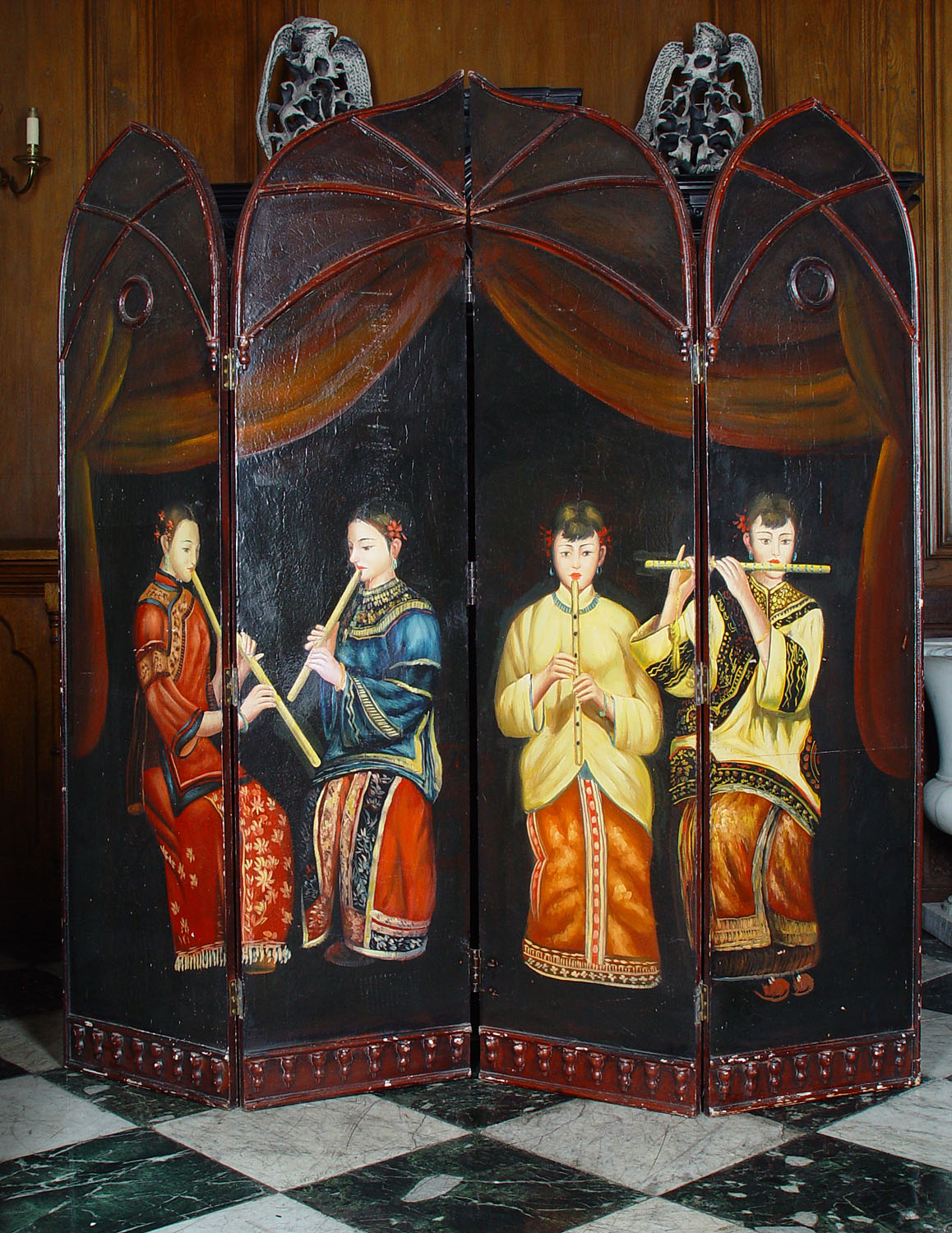 An Oriental style wooden four panel screen