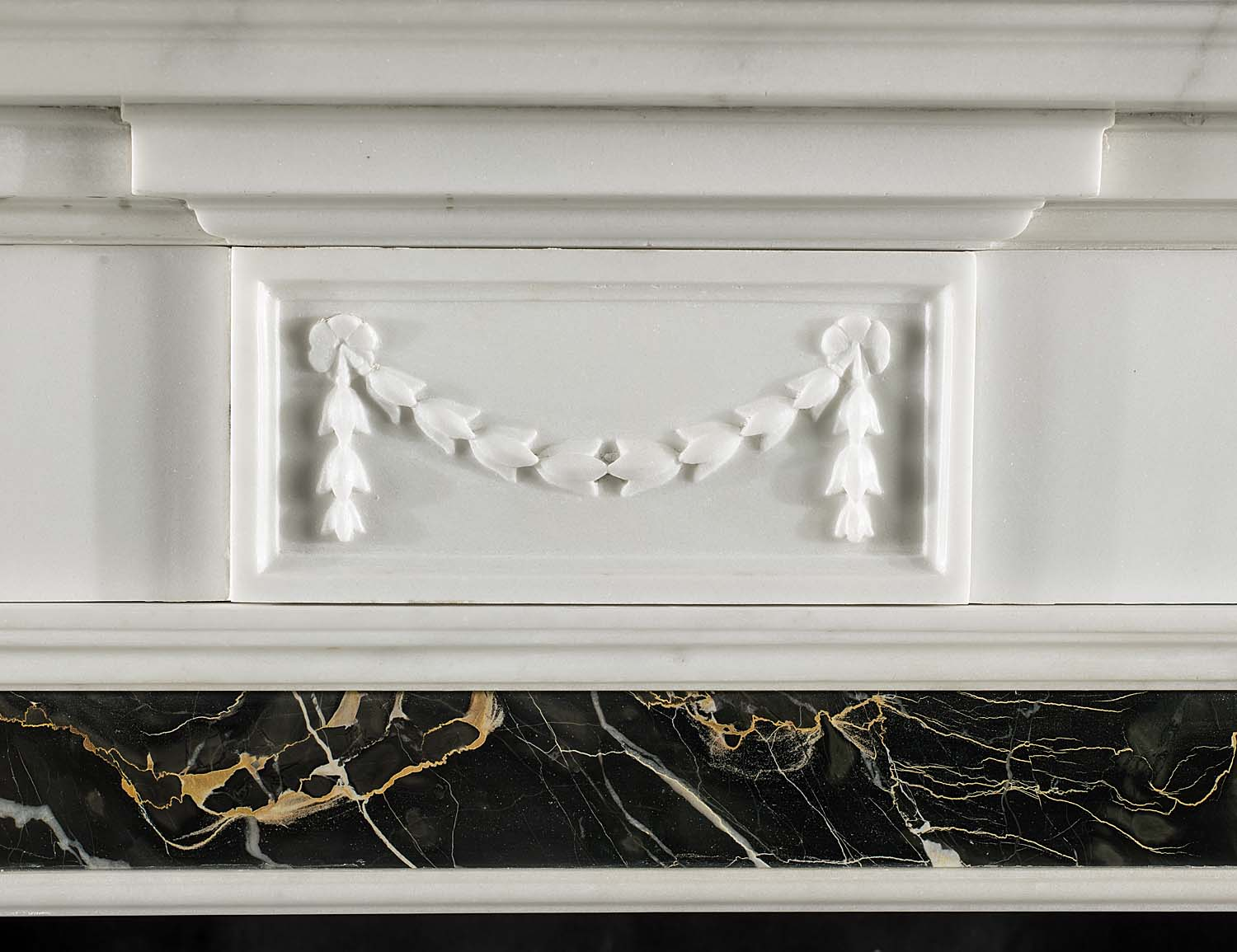 A Georgian style statuary and portoro marble antique fireplace surround