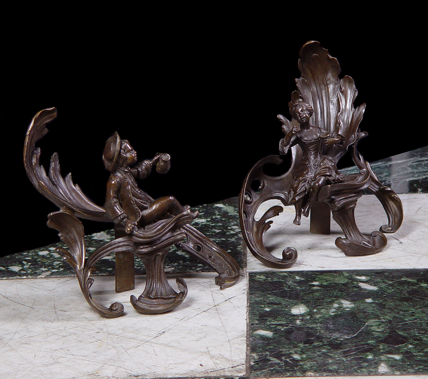 A pair of 20th century Louis XV style bronze Rococo chenets