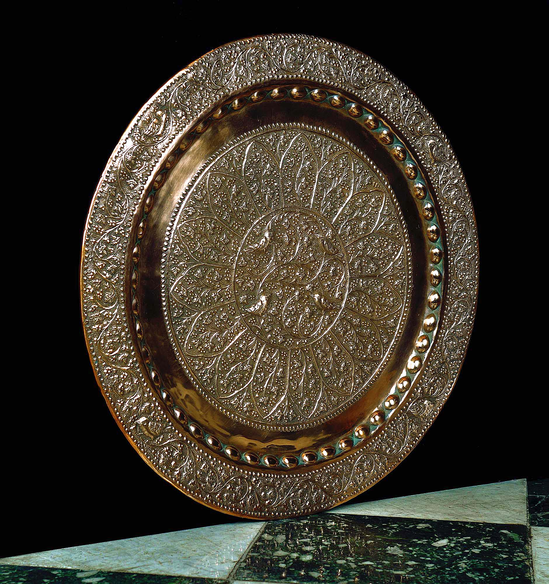 An Arts and Crafts antique copper roundel