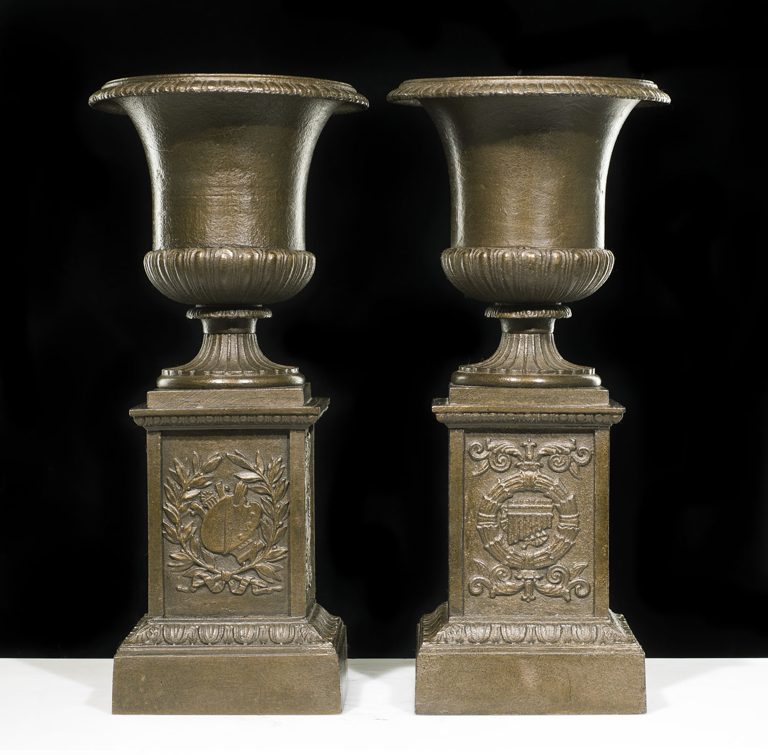 19th century pair of very small antique cast iron garden urns and plinths