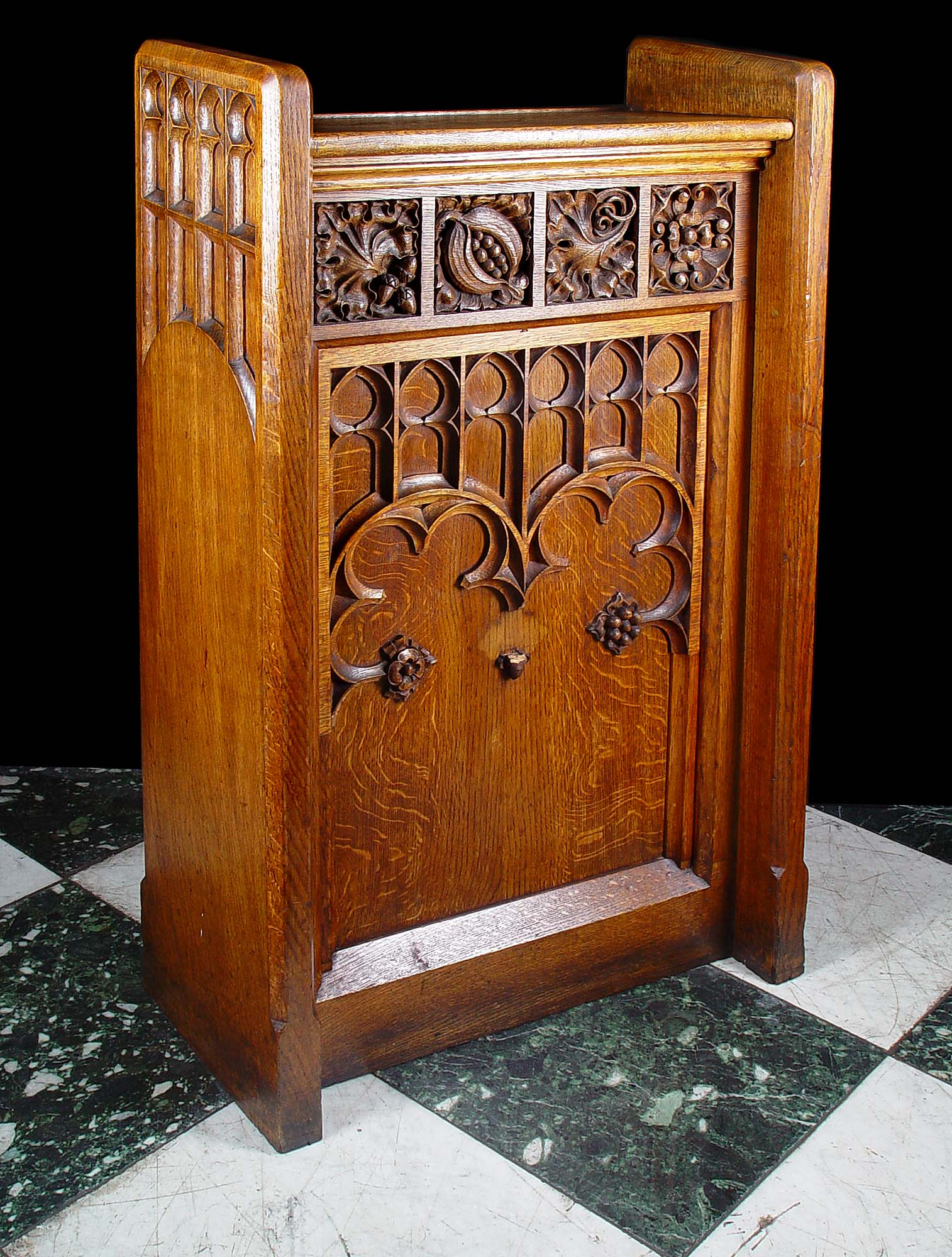 A Gothic Revival carved oak lectern