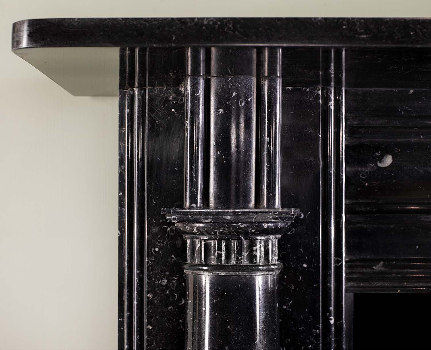 An elegant Irish Regency Kilkenny Fossil Black marble Antique Chimneypiece