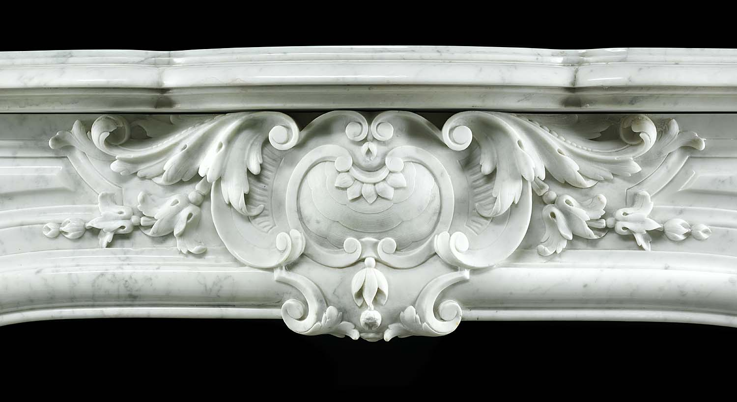 A very fine antique Rococo style Carrara white marble fireplace surround