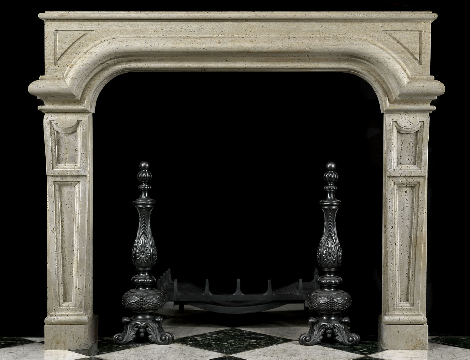 An early 20th century Italian Baroque chimneypiece carved in Travertine stone.