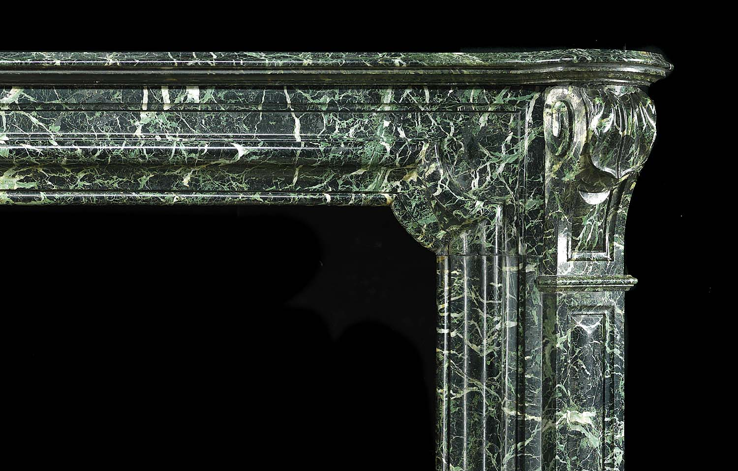 Antique Green Marble Bolection Louis XIV French Chimneypiece   A large Antique Baroque Bolection Green Marble Fireplace, in the French Louis XIV manner. The jambs are decorated with large scrolls and brackets. Mid 19th century.