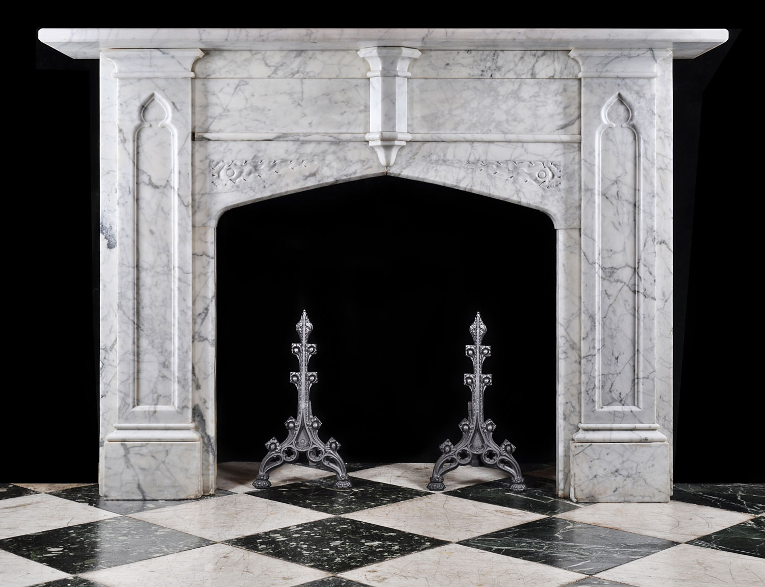 A statuary marble mid 19th century Neo Gothic chimneypiece