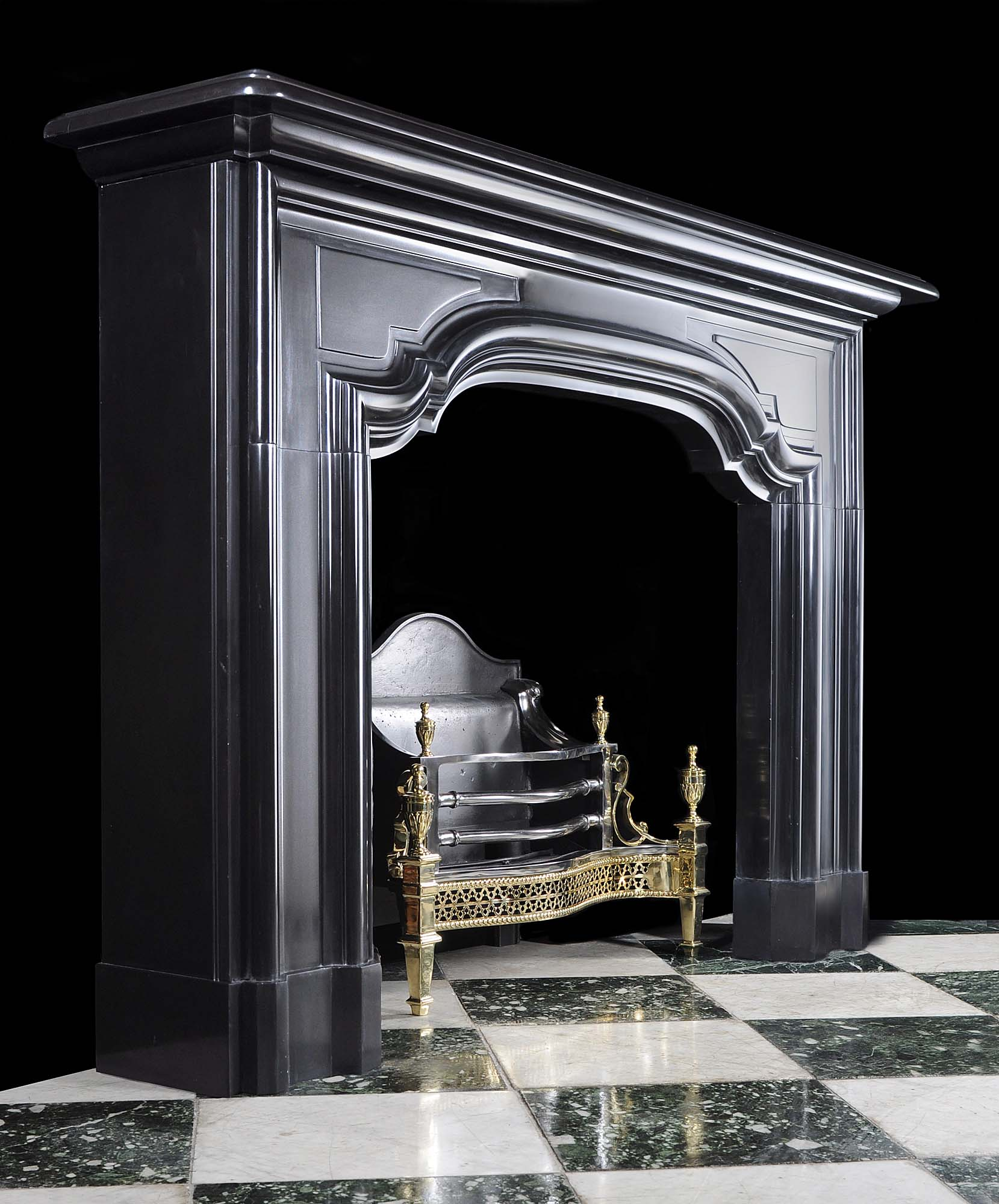 A large antique Belgian Black Marble Baroque Style Chimneypiece Mantel