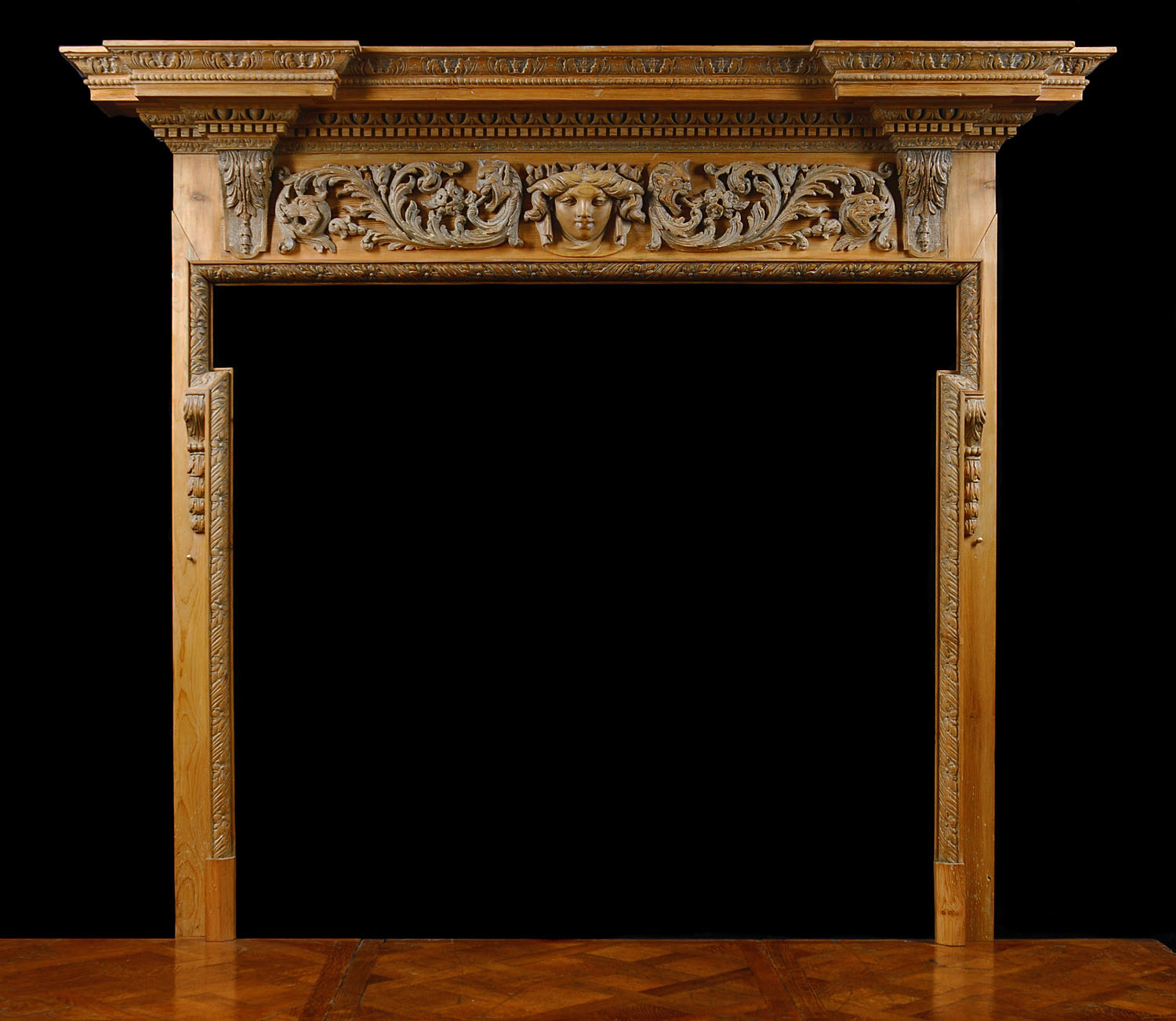An Antique William Kent style Pine Chimneypiece Mantel
