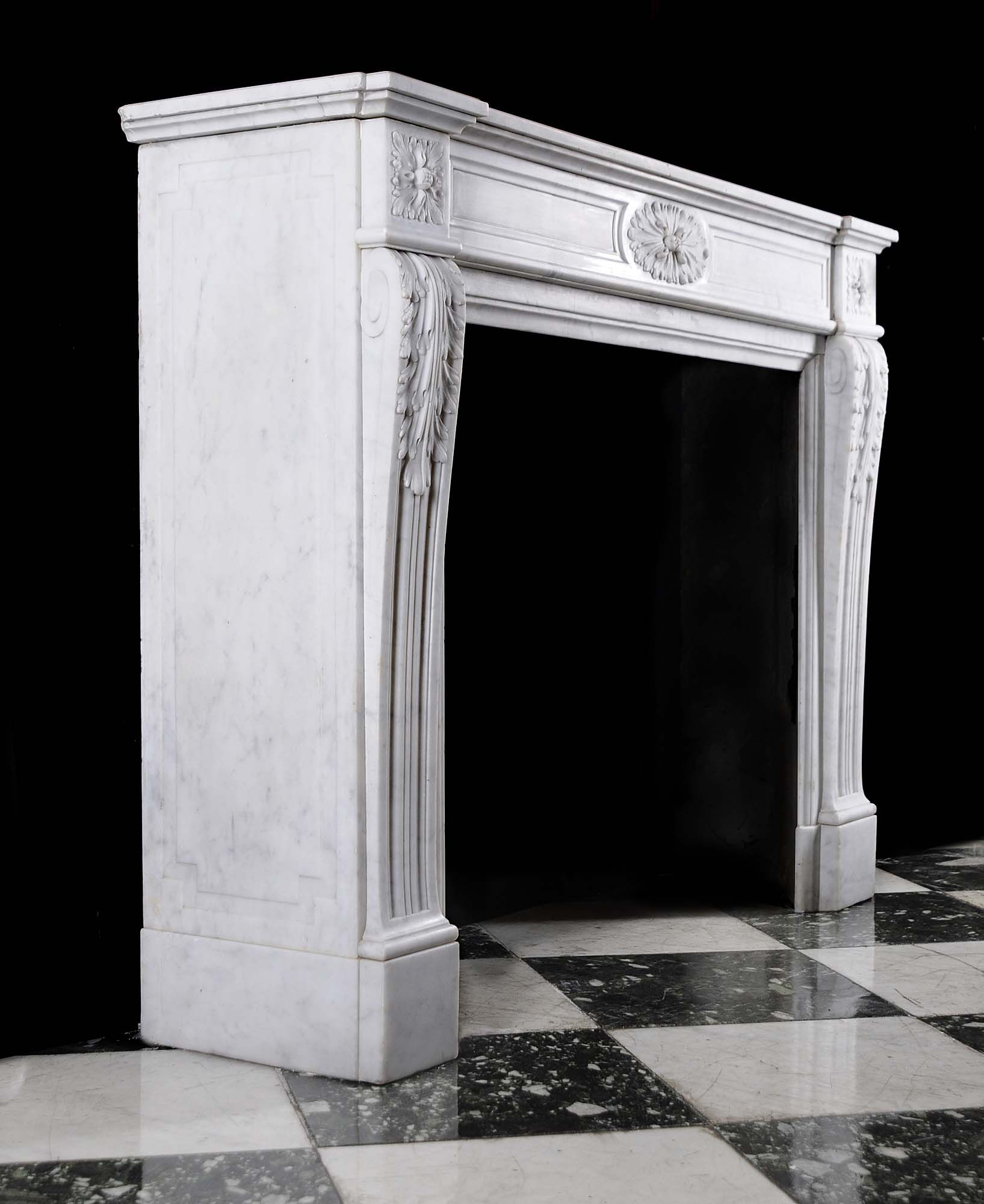 A small Carrara marble Louis XVI style antique chimneypiece