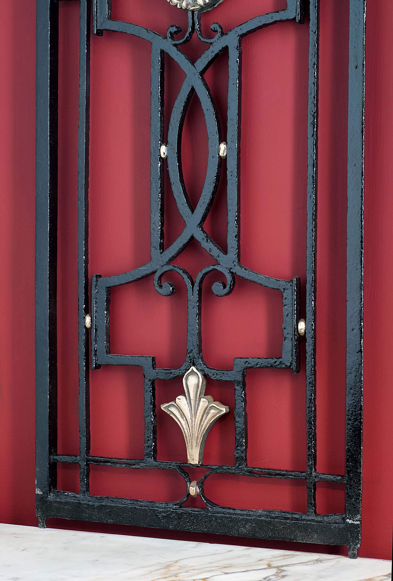 A pair of early 20th century bronze and wrought iron gates