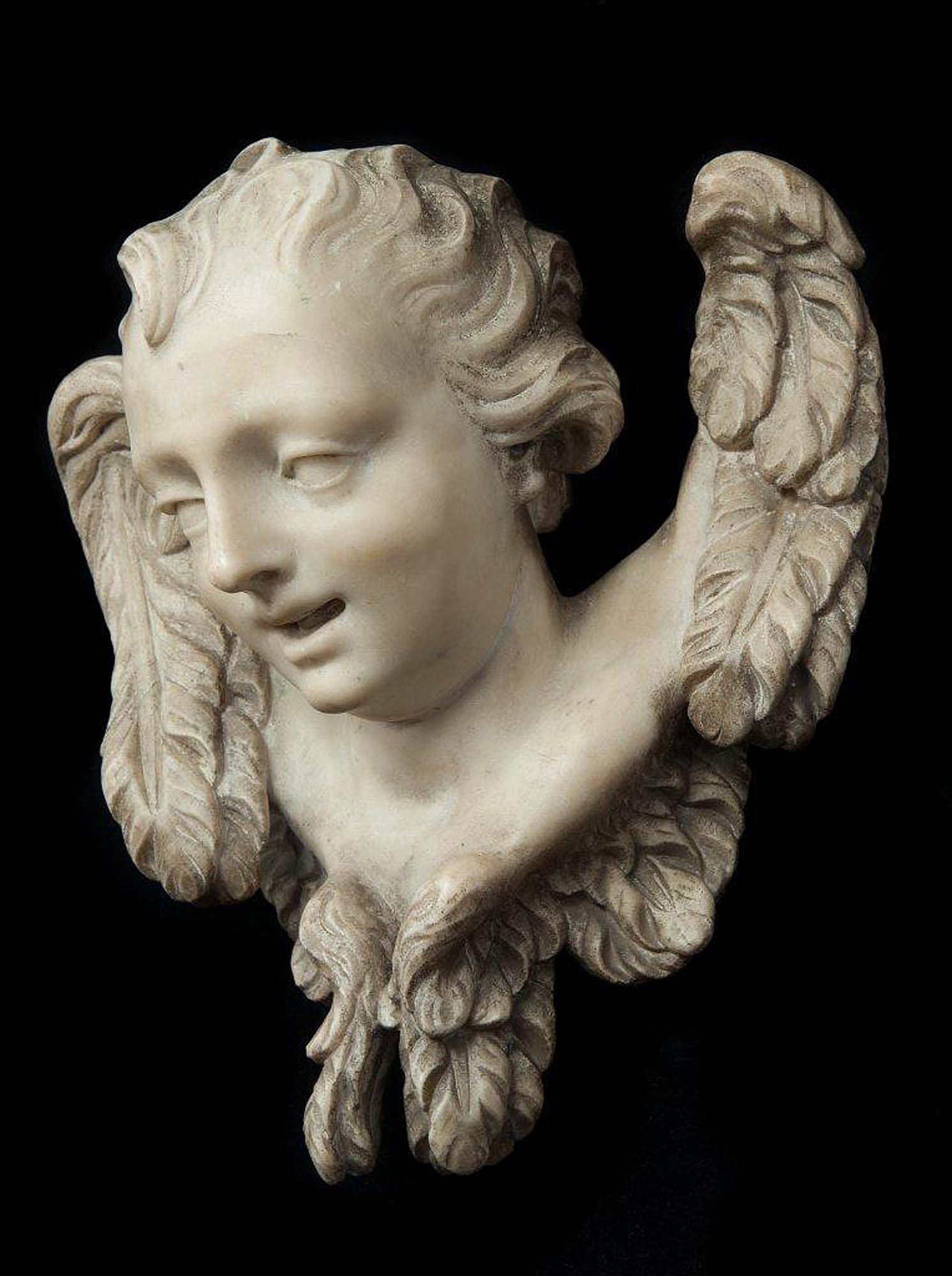 Antique marble sculpture of the head of an angel