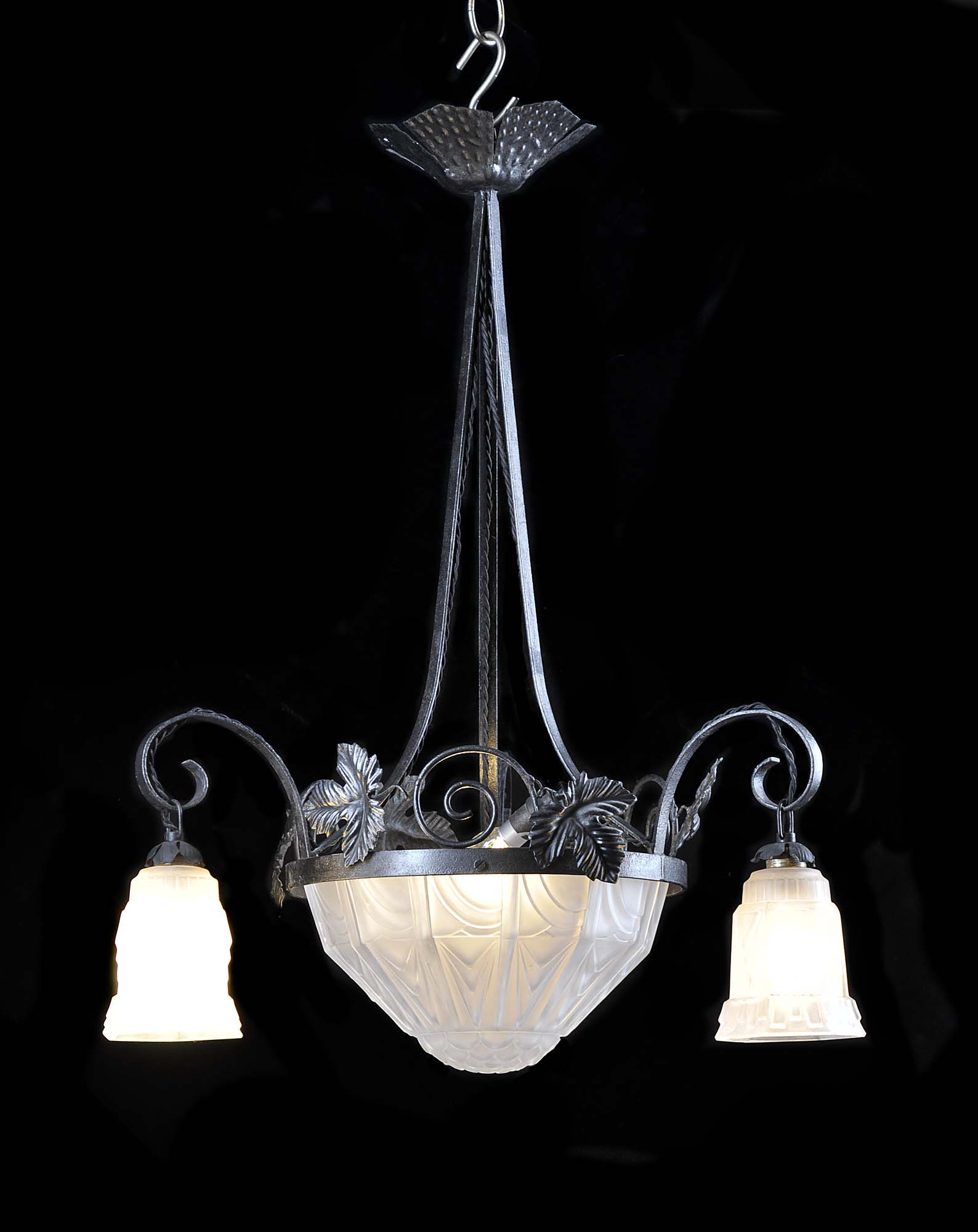 An Art Deco glass and patinated bronze ceiling light