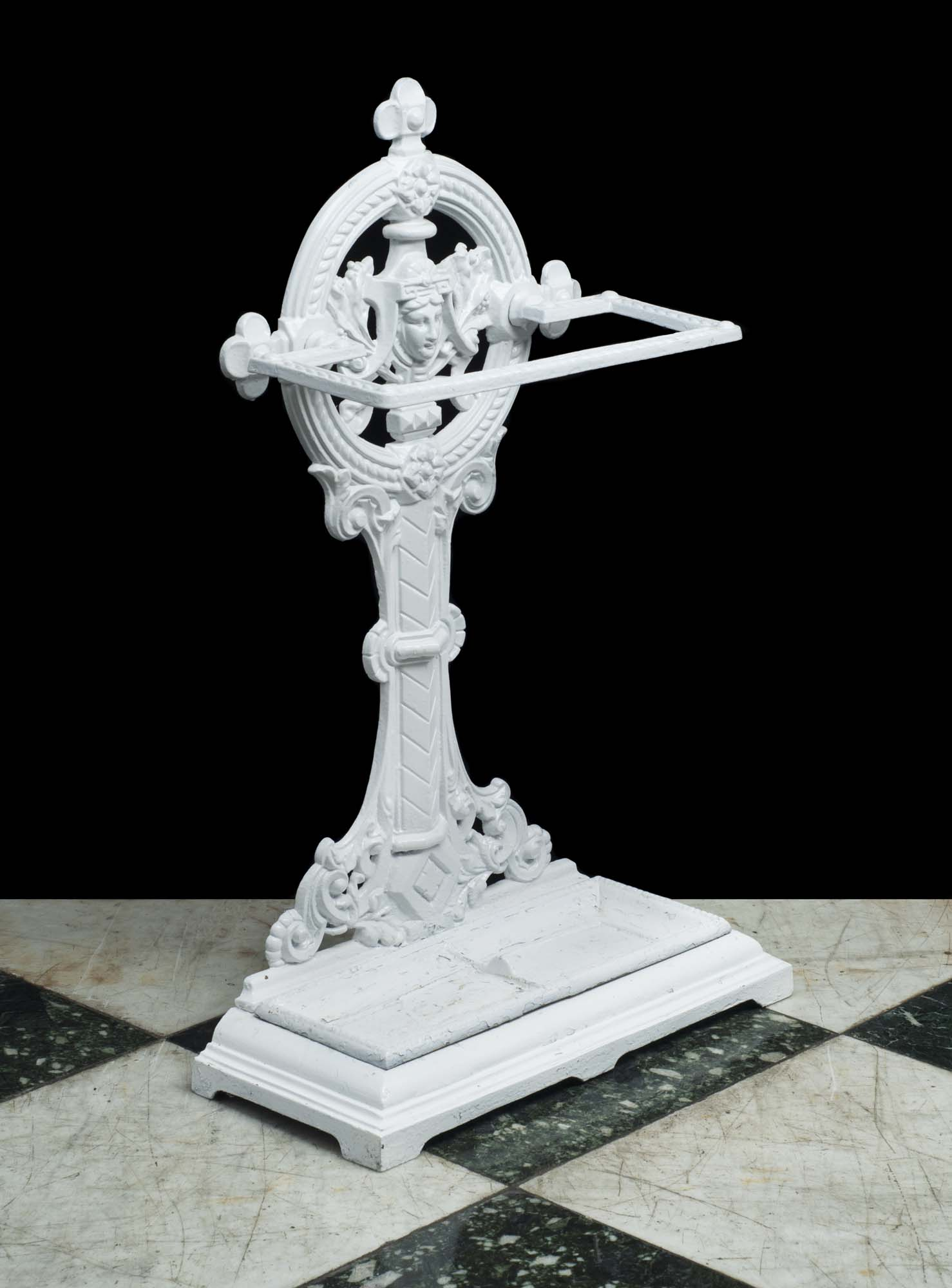 A white painted cast iron Victorian stick stand