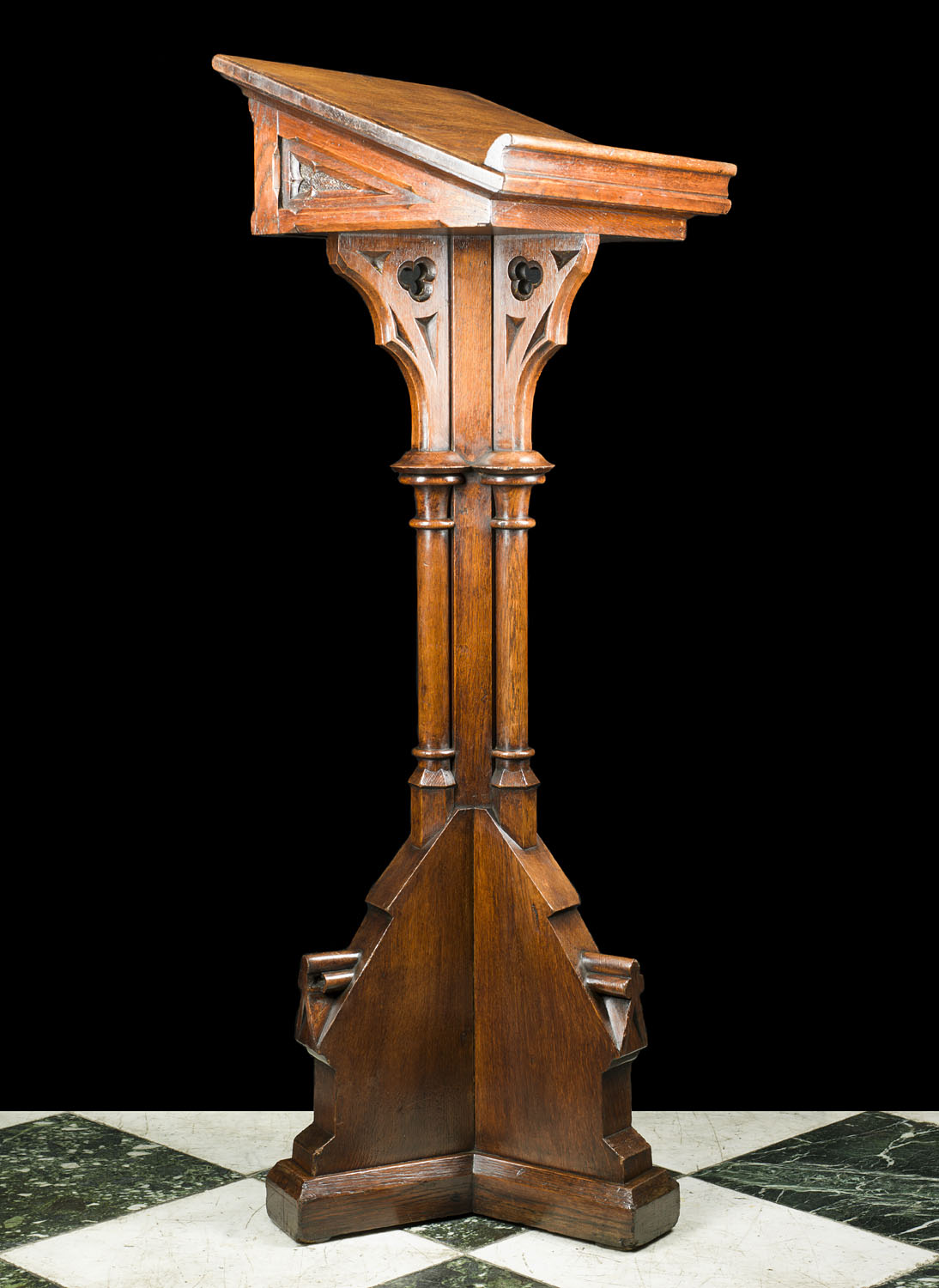 An Antique oak lectern in the Gothic manner
