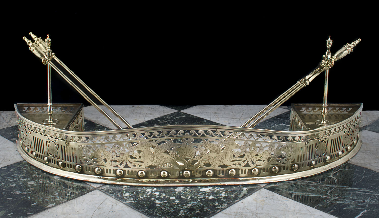 An Antique curved, pierced and engraved brass Fireplace Fender