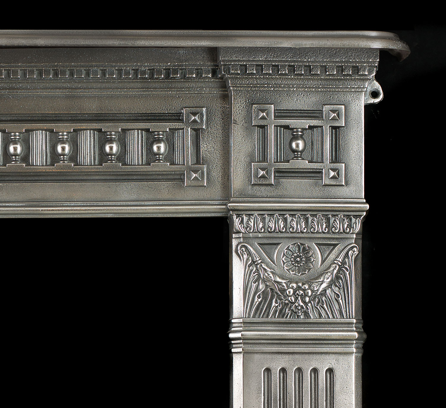 A tall polished cast iron l antique cast iron fireplace mantel