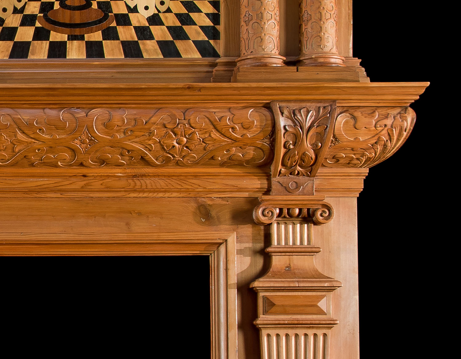 A Jacobean Revival inlaid cedar wood Fireplace Mantel