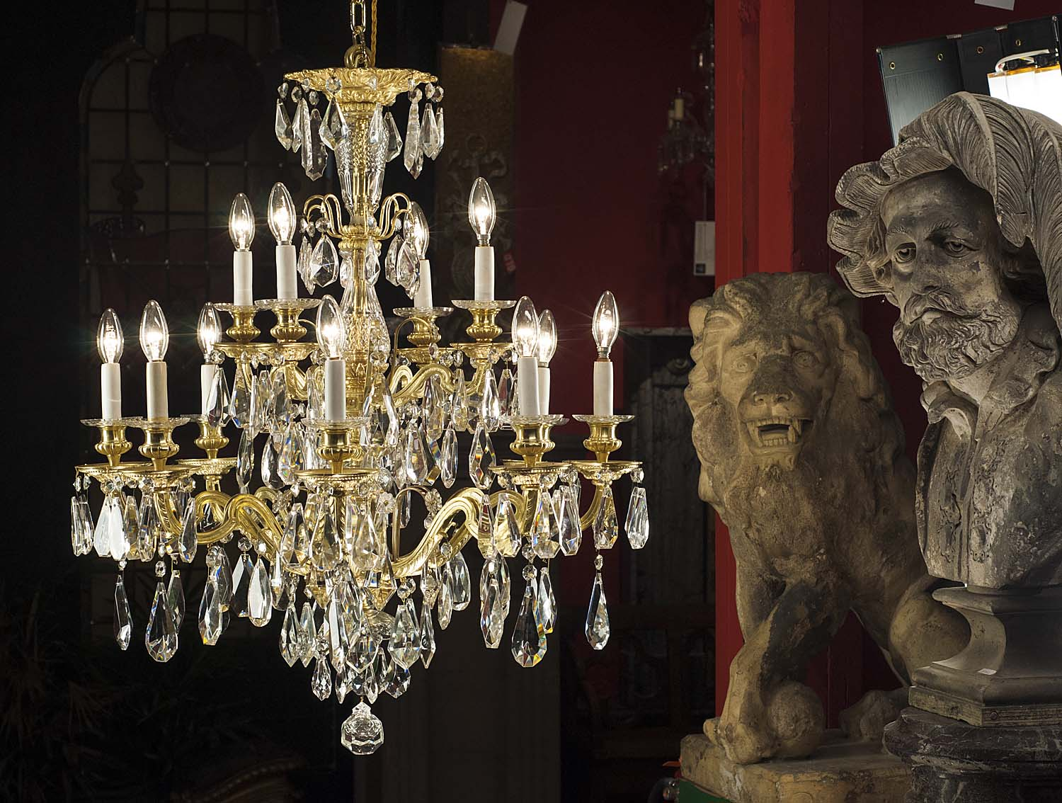 A twelve light antique cut crystal and bronze chandelier