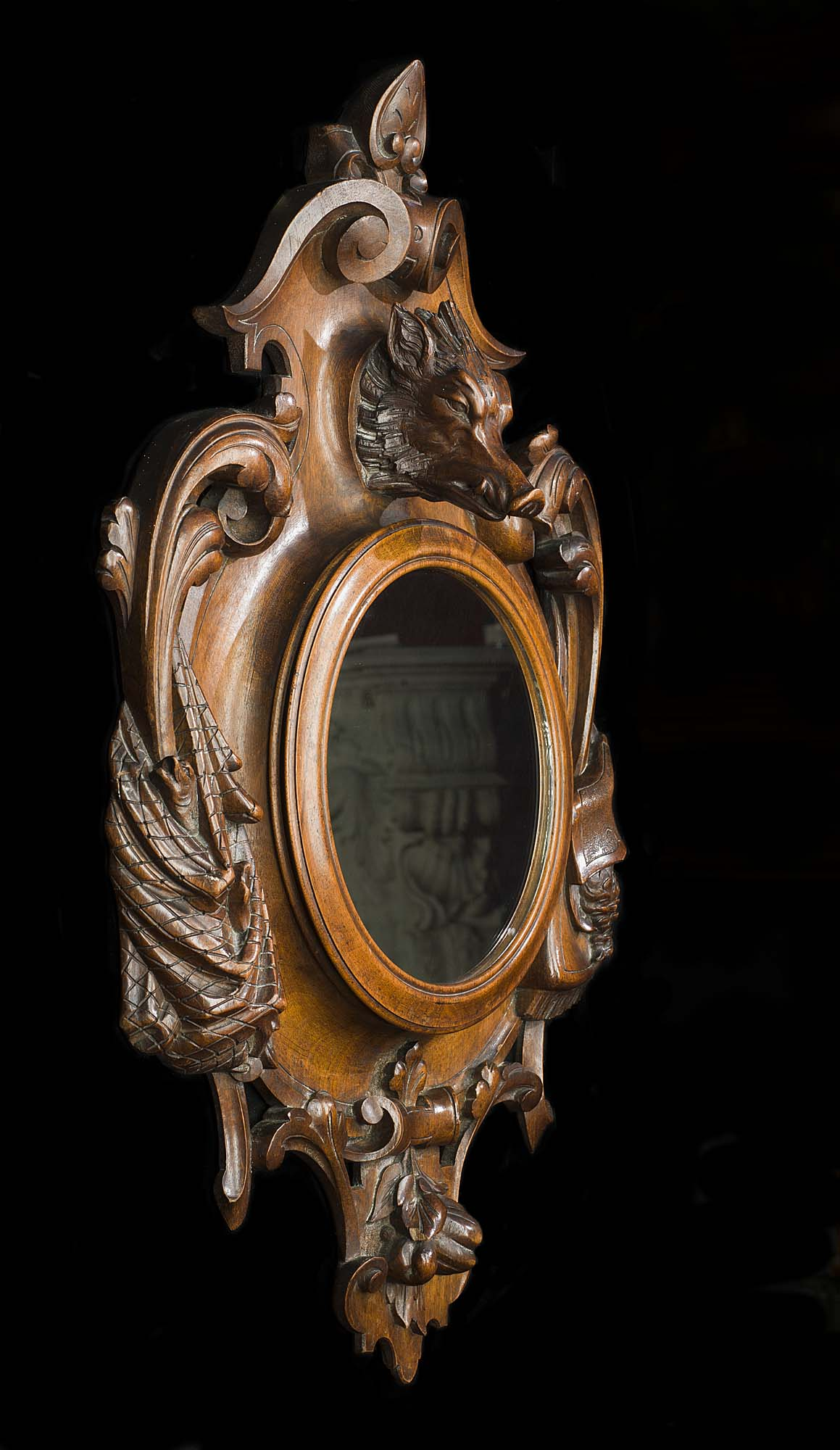 Victorian wall mirror framed in mahogany with a hunting theme