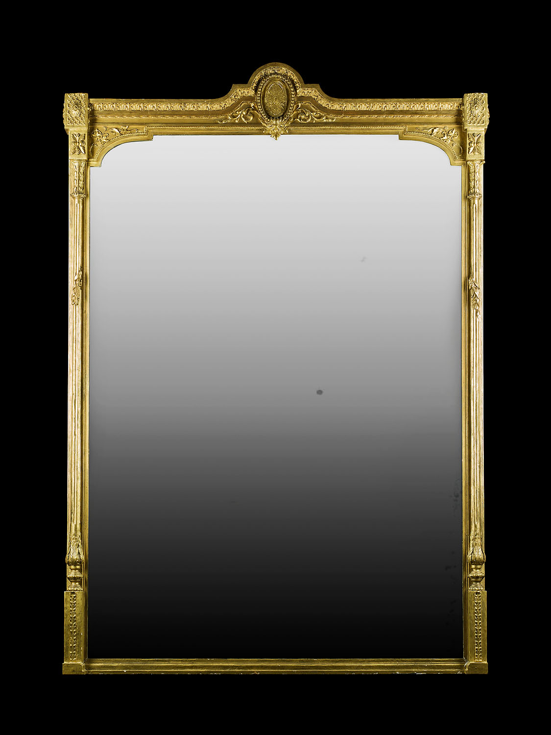 A large antique gilt wood mirror in the Louis XVI manner