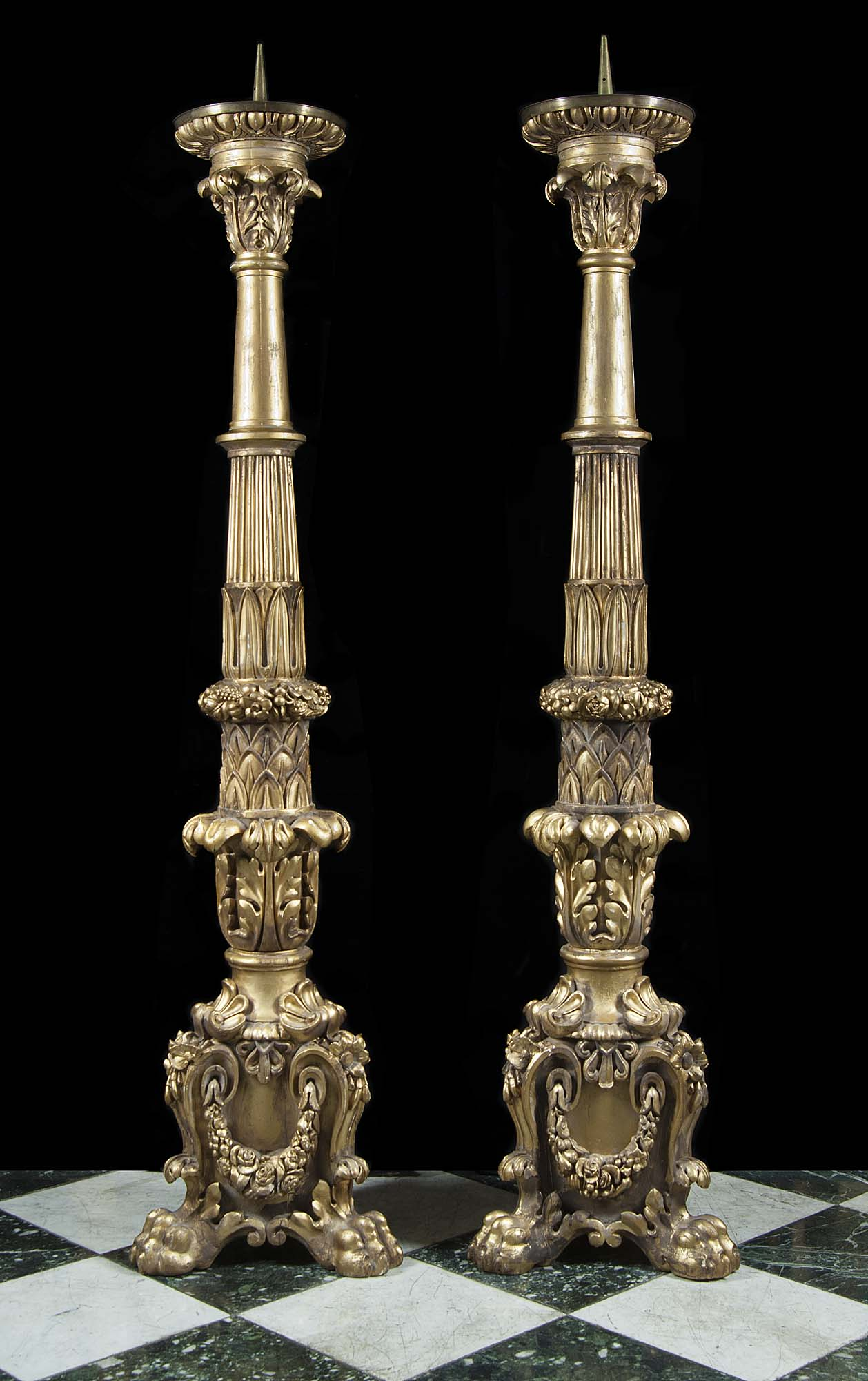 A pair of massive gilt wood Baroque style candlesticks