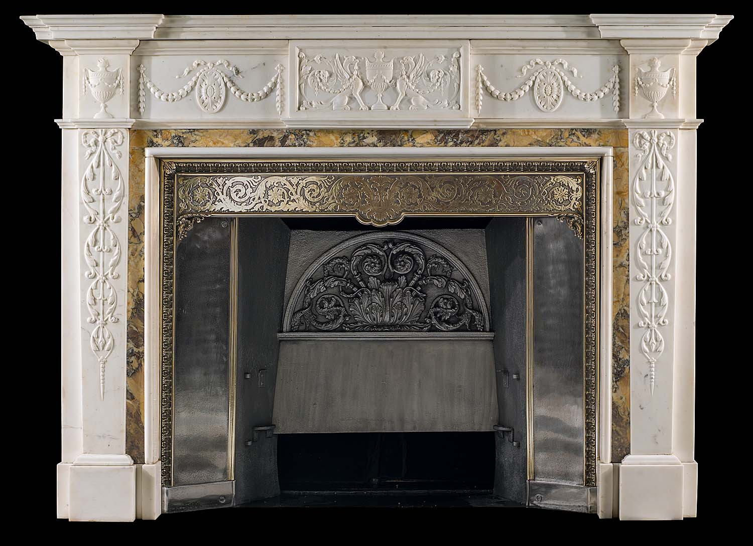 An Antique Georgian style statuary & siena marble fireplace surround