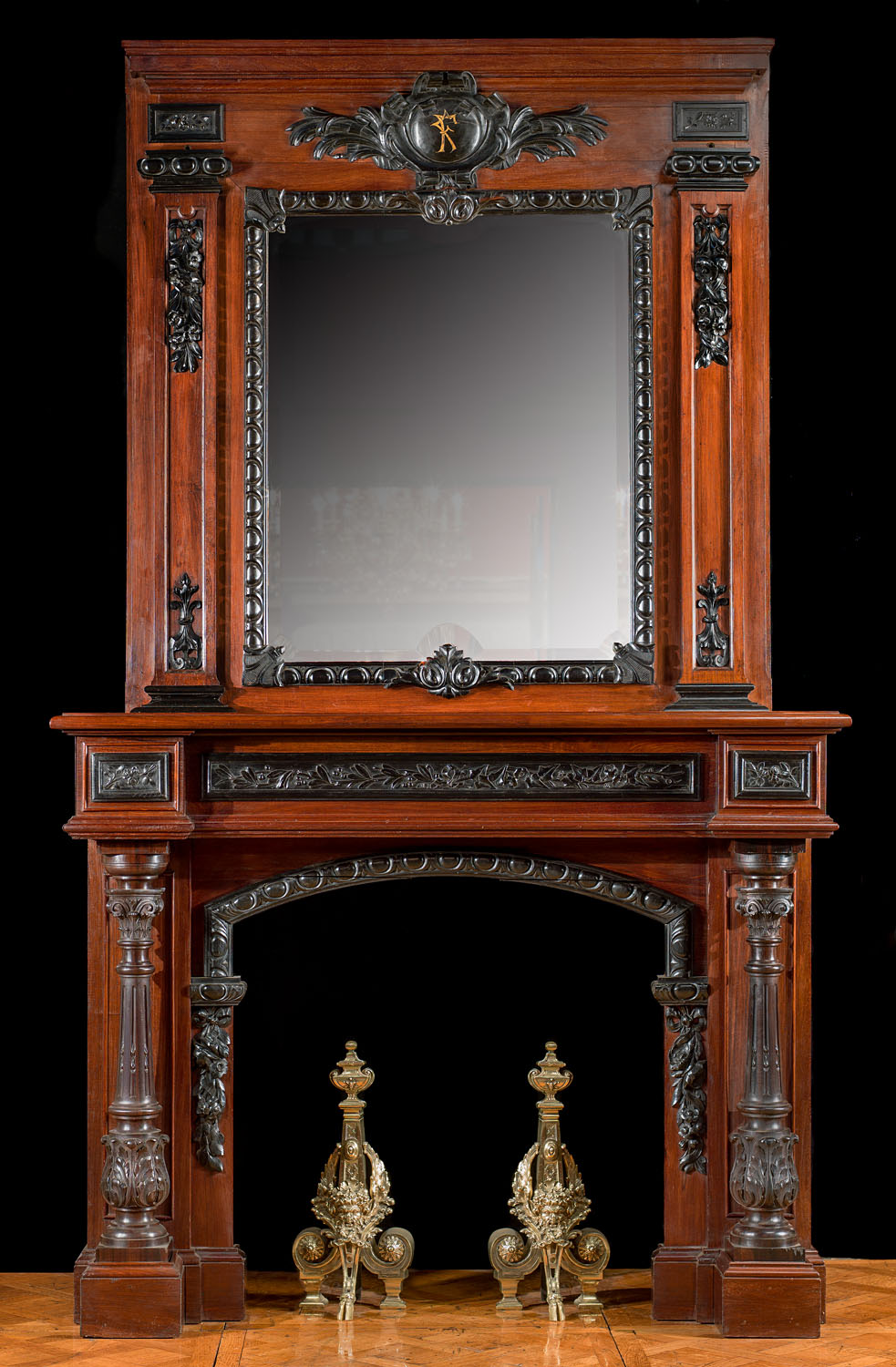 A grand French Victorian rosewood and ebony antique chimneypiece