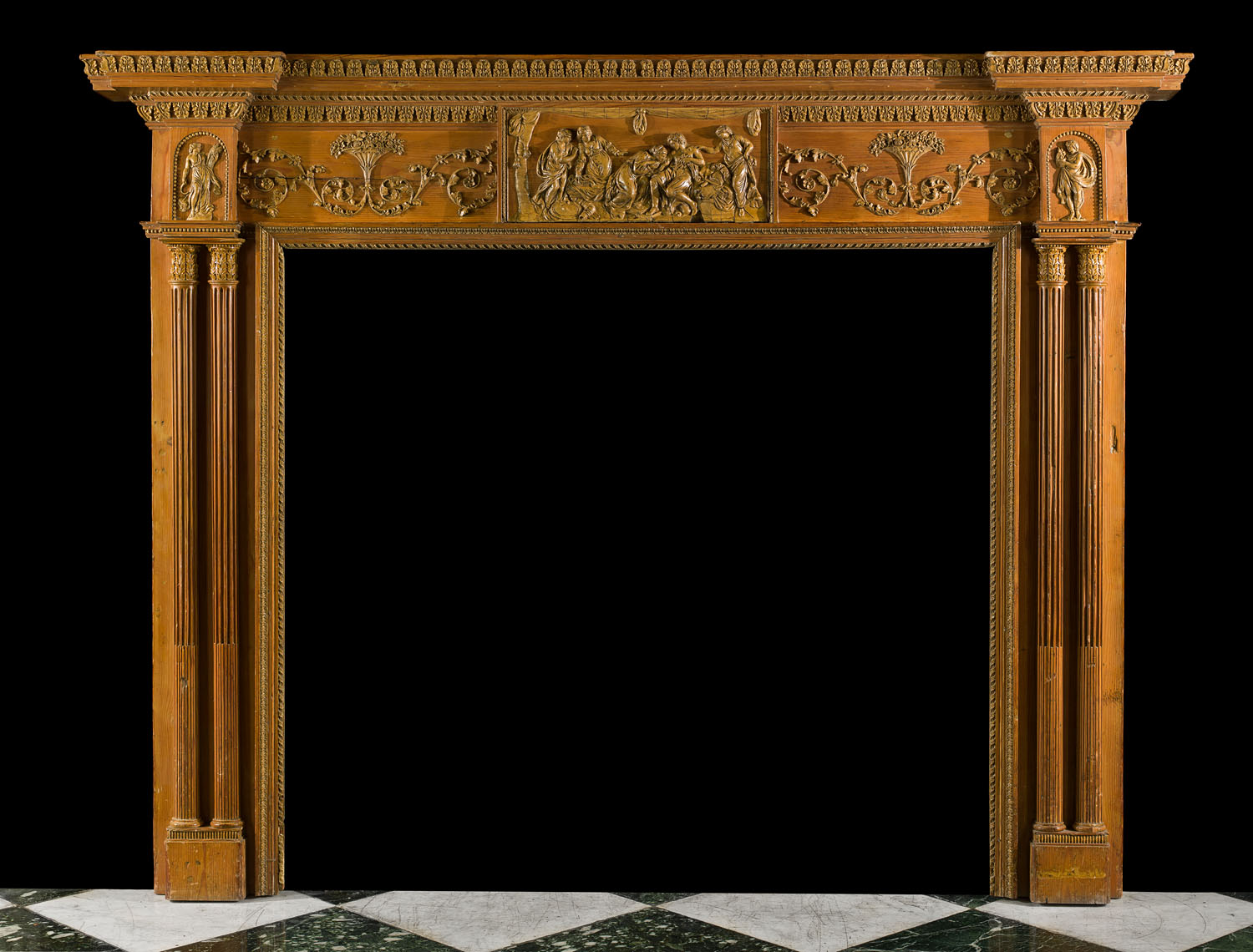 A carved pine and gesso Georgian fireplace surround