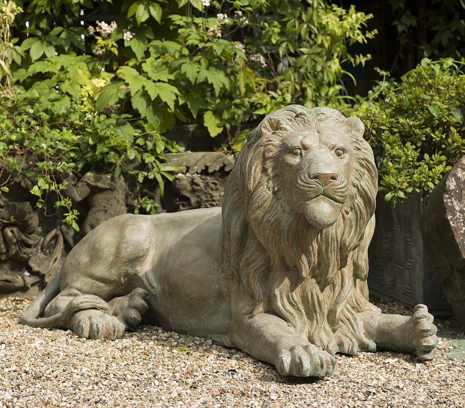 A pair of rather regal 20th century patinated bronze lions
