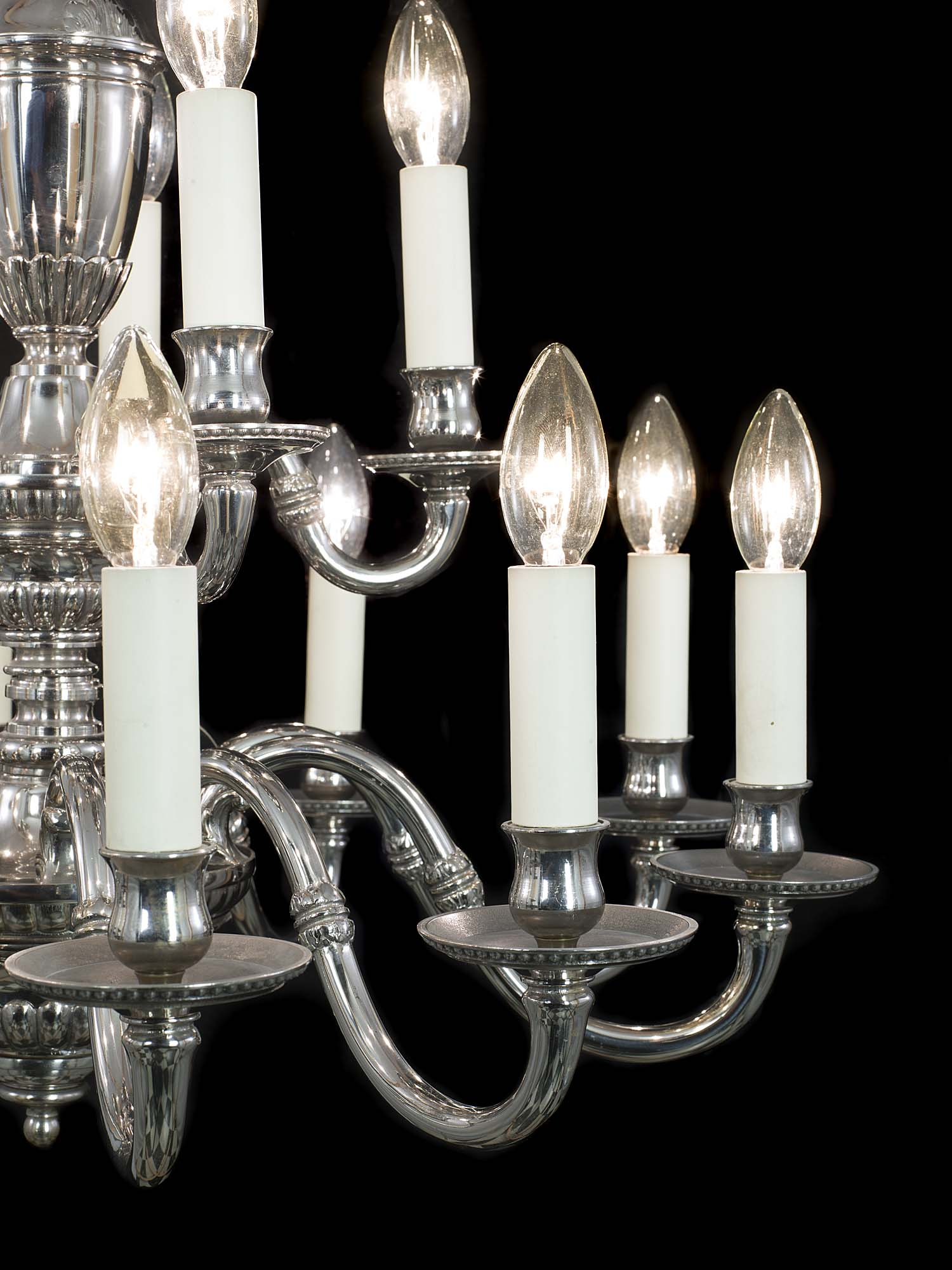 A complete set of two 20th century nickel plated brass chandeliers in two sets