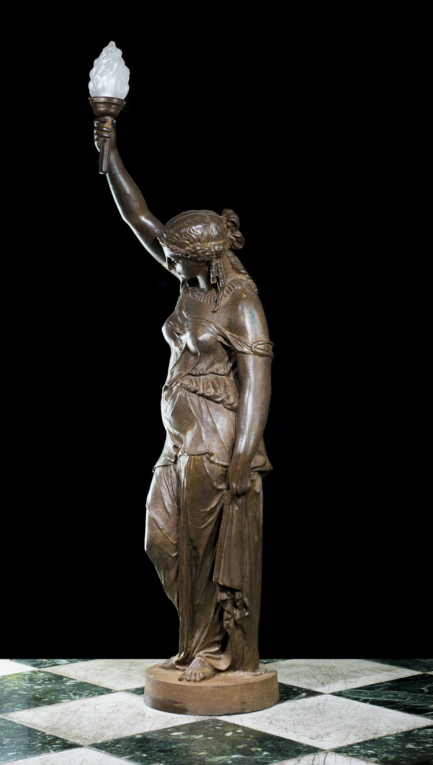 An Antique cast iron statue of Liberty