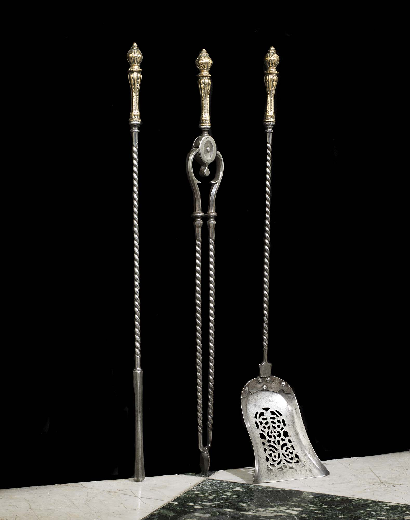 A set of George III antique steel & bronze fire irons