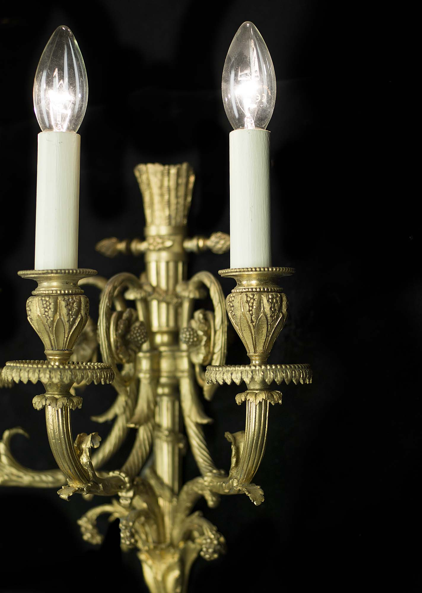 A 20th century pair of brass Neoclassical style wall lights