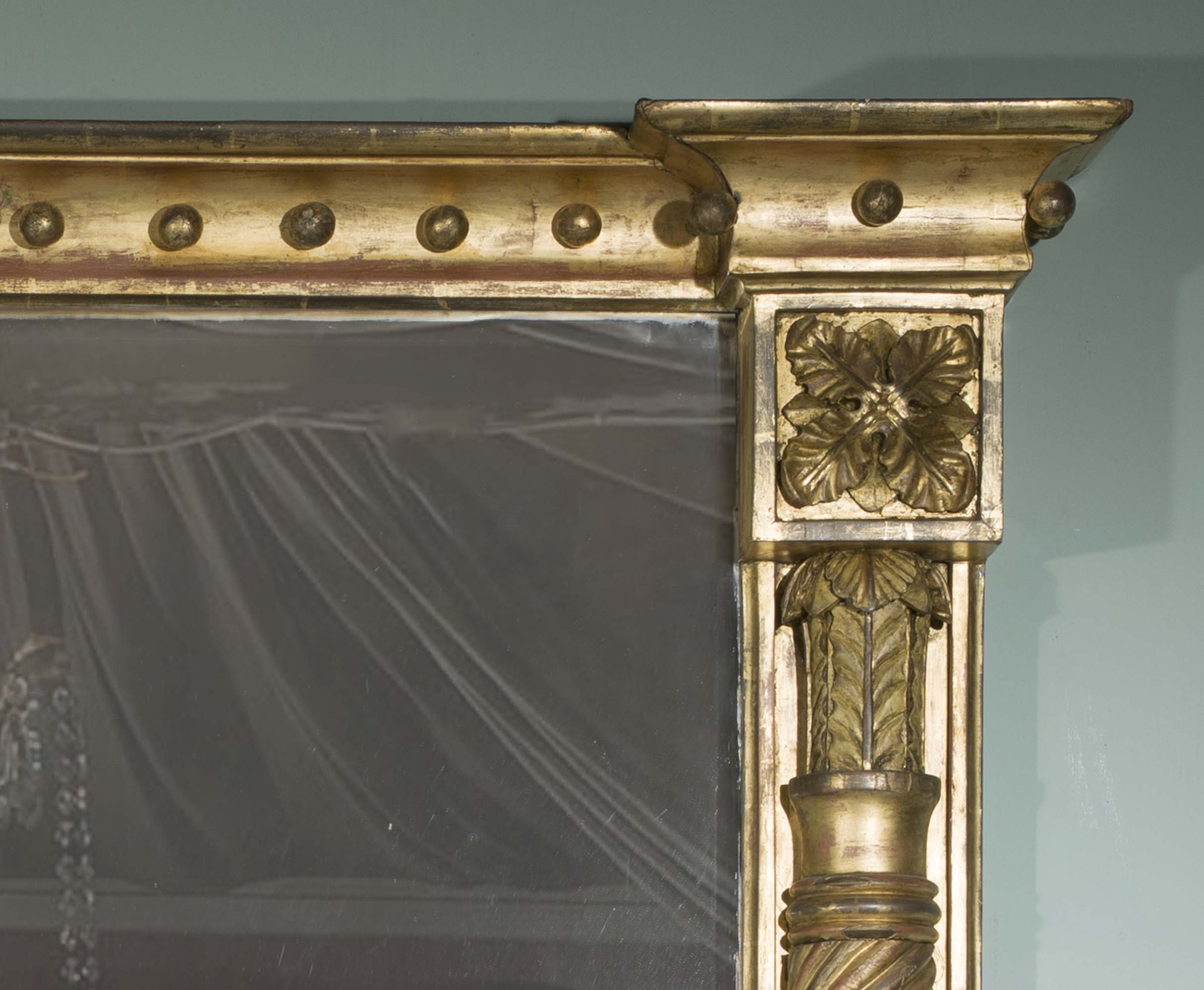 A giltwood and gesso Regency overmantel mirror
