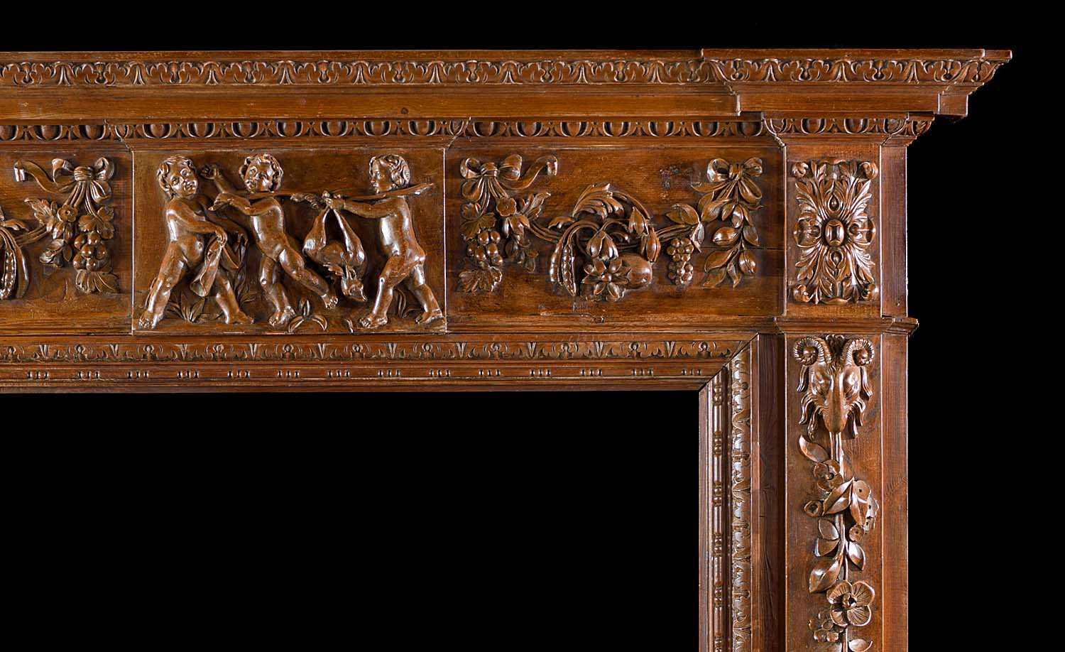 A finely carved pine Georgian style antique chimneypiece