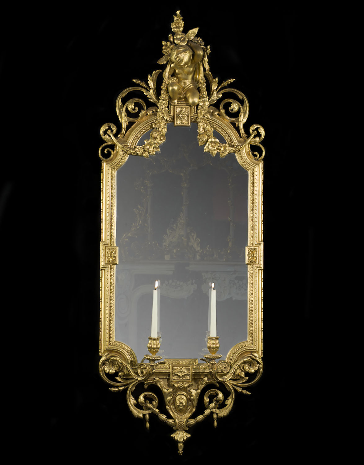 A large Rococo style giltwood and gesso antique girandole mirrror