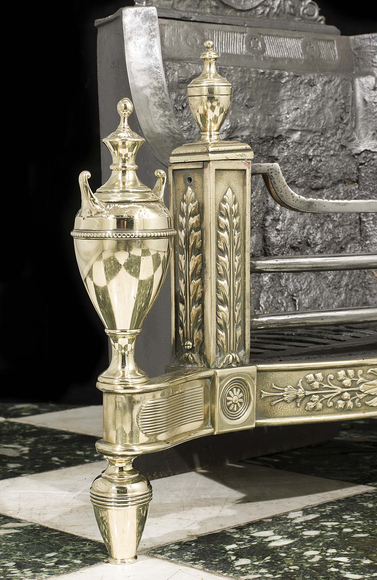 A Neoclassical style Victorian iron and brass antique fire basket
